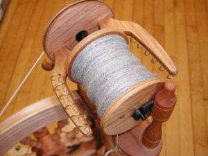 "photo of 2-ply yarn, gray alpaca/silk blend, on ""jumbo"" bobbin"